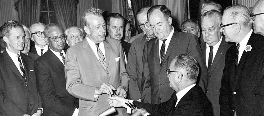At the signing ceremony for the Civil Rights Act of 1964, President Lyndon Johnson hands one of the pens he used to Senator Everett Dirksen.