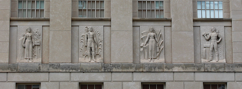"The Federal Building is decorated with four art-deco limestone bas-reliefs, carved onsite during a January blizzard by Chicago artist Freeman L. Schoolcraft.  L-R: ""Peoria Postal Worker,"" ""Potawatomi Native American,"" ""Woman of Peoria Agriculture"" and ""Man of Peoria Industry."""