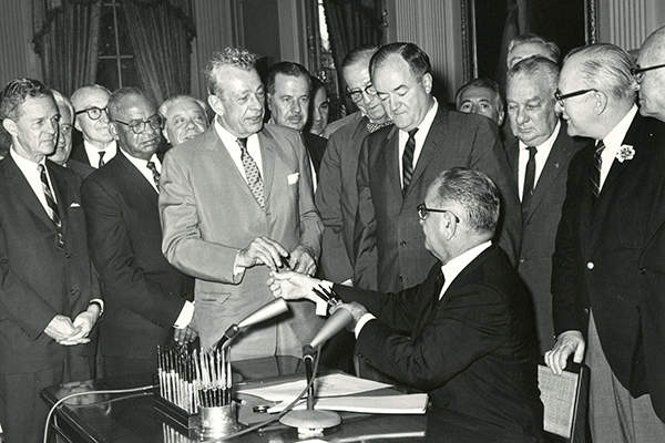 President Lyndon B. Johnson signs the Voting Rights Act of 1965