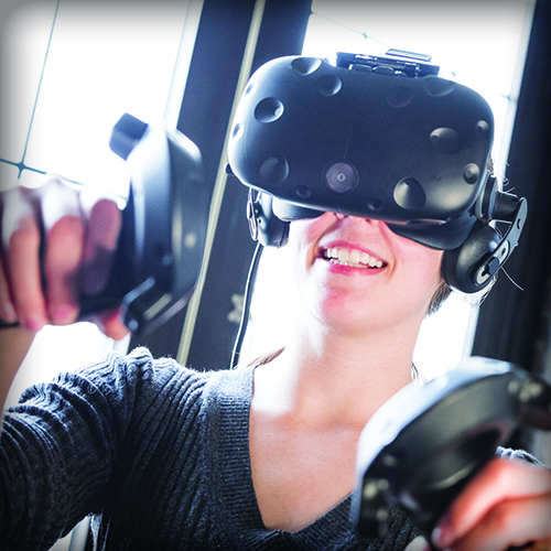 A woman using a virtual reality headset and controls
