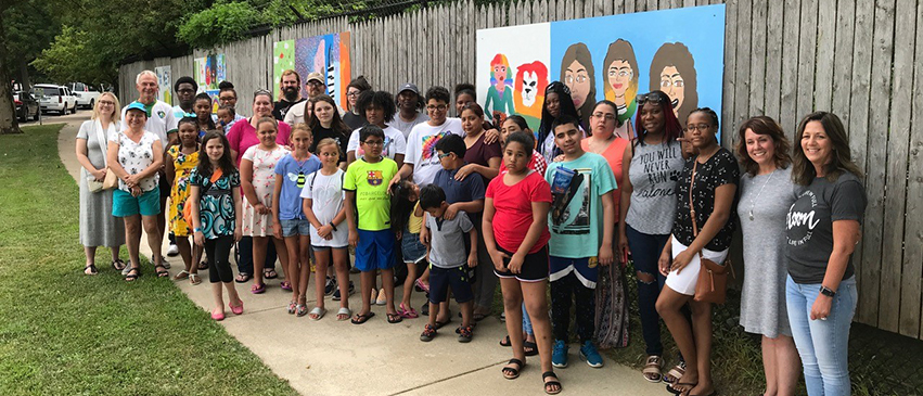 Ribbon cutting ceremony at Glen Oak Park for Big Picture's mural program with the Peoria Park District, July 2019