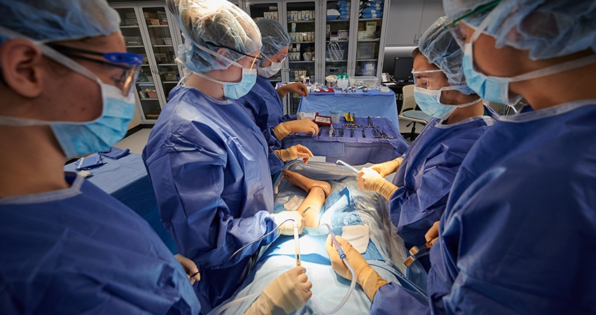 Students practice surgical care with real tools and equipment.
