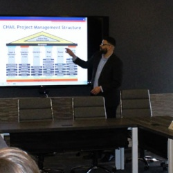 Lonnie Whisker, quality and performance improvement specialist and project portfolio manager at Children's Home, presents the organization's project management structure at a recent board meeting.