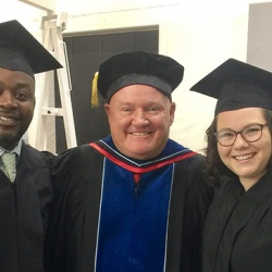 McMillan, center, with Anthony Rush, director of youth services at Children's Home, and Kirstin Ringel, volunteer coordinator with Habitat for Humanity, graduates of the Master's in Nonprofit Leadership program at Bradley University.