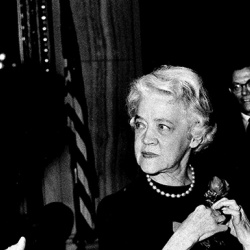 Smith converses with Dirksen while affixing her iconic rose pin to her dress, 1966. Just as Dirksen advocated for the marigold as the national flower, Smith advocated for the rose—which it became in 1986, after Dirksen's death.