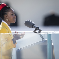 "Amanda Gorman recites her poem, ""The Hill We Climb,"" during the 59th presidential inauguration ceremony in Washington, DC, January 20, 2021. DOD photo by Navy Petty Officer 1st Class Carlos M. Vazquez II"