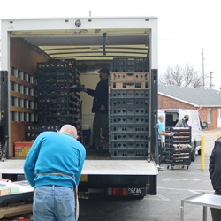 More than three dozen volunteers collect food donations every day for distribution to over 75 local organizations.