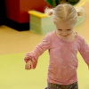 Young girl playing at the Peoria PlayHouse Children's Museum