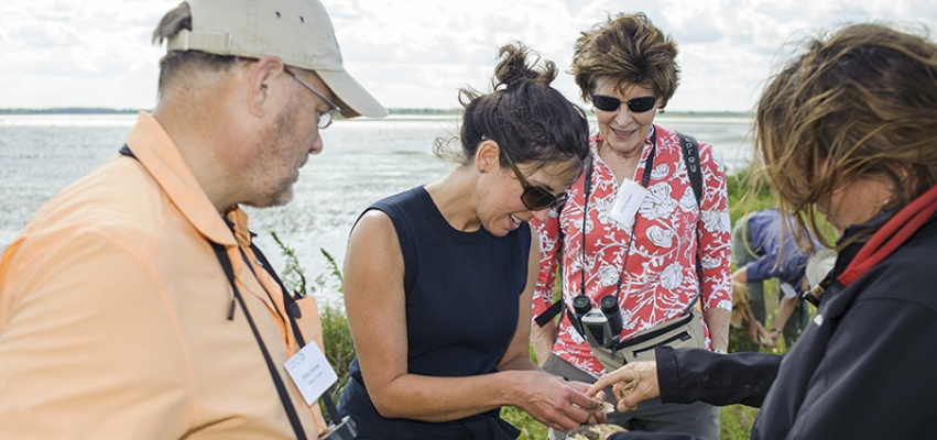 TNC State Director Michelle Carr inspects mussels discovered by TNC Aquatic Biologist Maria Lemke at Emiquon National Wildlife Refuge