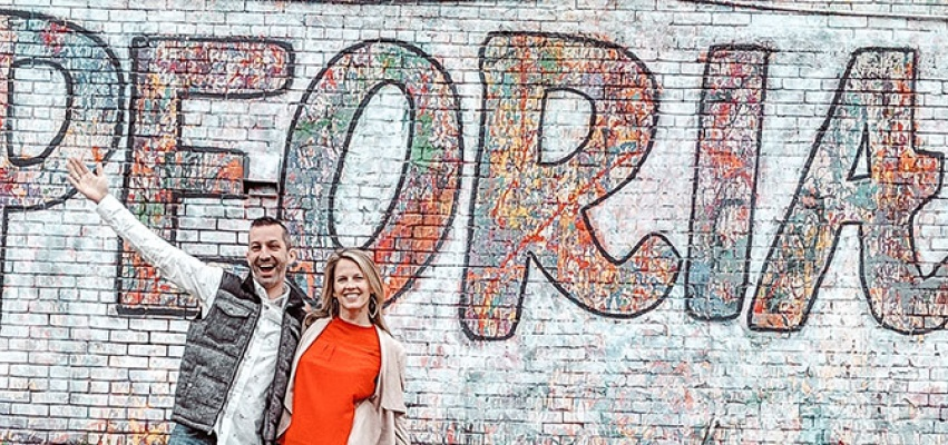 Cliff & Jodie Vieira in front of the Hello Peoria mural