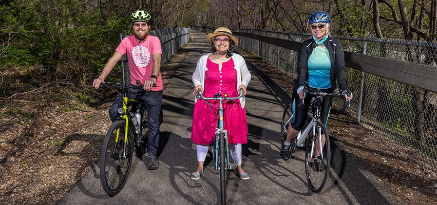 Kathy Jones, Evan Stumpges and Michelle Perkinson on the Rock Island Greenway behind Trefzger's Bakery, April 12, 2021. Photograph by Jeffery Noble
